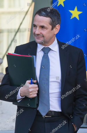 French Minister of State for Higher Education Thierry Mandon leaves the Elysee Palace after the weekly cabinet meeting in Paris