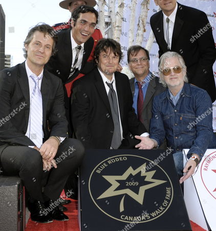 The Band Blue Rodeo (l-r) Jim Cuddy Glenn Milchem Bazil Donovan Bob Egan and Greg Keelor Pose with Their Sidewalk Star at the 12th Annual Canada's Walk of Fame Ceremony in Toronto Canada On 12 September 2009 the Walk of Fame Ceremony Honors Those Who Have Excelled in Music Sport Science Innovation and Entertainment
