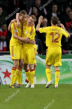 Fc Liverpool Forward Peter Crouch Celebrates with Teammates John Arne Riise (c) and Fabio Aurelio After He Scored a Goal Against Psv Eindhoven During Their Quater Final First Leg Champions League Match in Eindhoven Netherlands Tuesday 03 April 2007