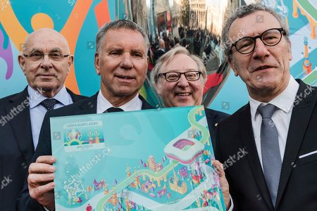 The Mayor of Brussels Yvan Mayeur, right, the Vice President of UEFA Michael Van Praag, left, the President of EURO Brussels 2020 Alain Courtois, 2nd left, and the President of the Belgian Football Association Francois De Keersmaecker pose with the Brussels EURO 2020 Host City logo at the City Hall in Brussels on