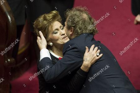 Stock Image of Senator Paola Pelino embraces Minister of Sport Luca Lotti