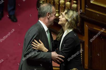 Senator Roberto Calderoli embraces Minister of Public Administration Marianna Madia