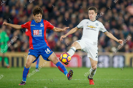 Ander Herrera of Manchester United and Chung-Yong Lee of Crystal Palace during the Premier League match between Crystal Palace and Manchester United played at Selhurst Park Stadium, London on 14th December 2016