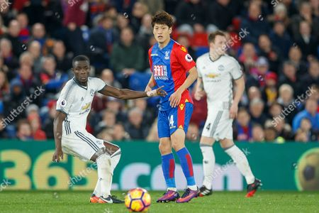 Chung-Yong Lee of Crystal Palace and Eric Bailly of Manchester United during the Premier League match between Crystal Palace and Manchester United played at Selhurst Park Stadium, London on 14th December 2016