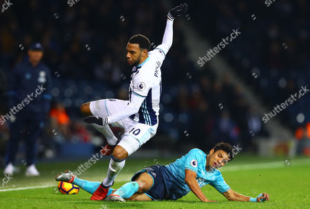 Matt Phillips of West Bromwich Albion is tackled by Neil Taylor of Swansea City during the Premier League match between West Bromwich Albion and Swansea City played at The Hawthorns, West Bromwich on 14th December 2016