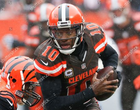 Cleveland Browns quarterback Robert Griffin III runs in the first half of an NFL football game against the Cincinnati Bengals, in Cleveland. Browns coach Hue Jackson said Griffin III needs to be better this week in his second game back since breaking a bone in his left shoulder in the opener