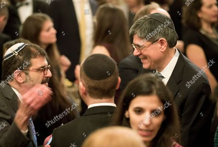 Treasury Secretary Jack Lew, top right, attends a Hanukkah reception hosted by President Barack Obama and first lady Michelle Obama, in the East Room of the White House in Washington