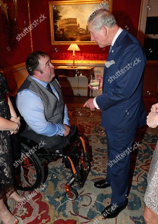 Prince Charles chats with former bomb disposal soldier Ken Bellringer at the 'Style for Soldiers' Christmas Reunion Party