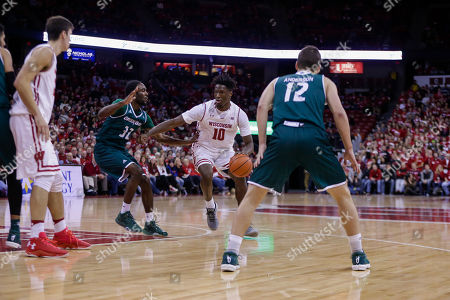 Wisconsin's Nigel Hayes (10) and Green Bay's Tevin Findlay (32) and Trevor Anderson (12) during the second half of an NCAA college basketball game, in Madison, Wis. Wisconsin won 73-59