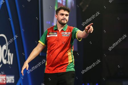 Jamie Lewis celebrates victory in his first round match against Mick McGowan during the William Hill World Darts Championship at Alexandra Palace, London