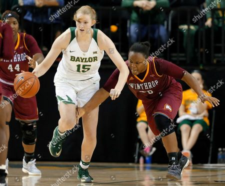 Stock Image of Lauren Cox, Erica Williams Baylor's Lauren Cox (15) makes a steal against Winthrop's Erica Williams, right, in the second half of an NCAA college basketball game, in Waco, Texas
