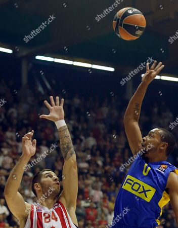 Maccabi Tel Aviv's Andrew Goudelock, right, drives to the basket as Stefan Jovic of Red Star tries to block him during their Euroleague basketball match in Belgrade, Serbia