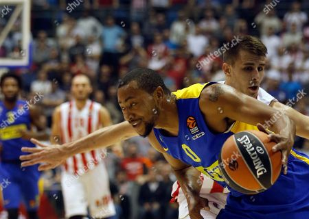 Maccabi Tel Aviv's Andrew Goudelock, front, drives to the basket as Nemanja Dangubic of Red Star tries to block him during their Euroleague basketball match in Belgrade, Serbia