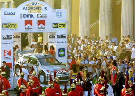 Athens Greece : Britains Richard Burns and His Co-pilot Robert Reid Leave the Ramp in Their Peugeot 206 Wrc Rallye Car at the Start of the 49th Edition of the Acropolis Rally Outside Zappeion Megaron in Athens Thursday 13 June 2002