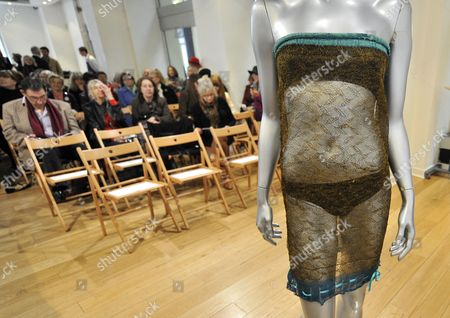 Kate Middleton's See-through Lace Dress is Pictured at an Auction in London Britain 17 March 2011 the See-through Knitted Lace Dress Designed by British Designer Charlotte Todd and Worn by Britain's Prince William's Bride to Be Kate Middleton at the St Andrew's Annual Charity Fashion Show in 2002 is Scheduled to Be Sold As Part of Kerry Taylor Auctions' Passion For Fashion and Fine Textiles Sale the Dress Which is Expected to Fetch Between 9 000 and 11 000 Euros is Supposedly to Have Been a Factor in Middleton's Meeting with Prince William the Auction Also Includes Two Dresses Worn by Princess Diana and a Number of Items Once Owned by King Edward Viii's Mistress Wallis Simpson United Kingdom London