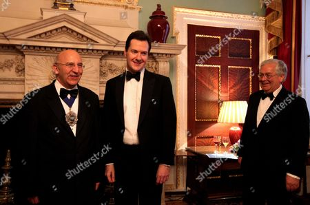 The Lord Mayor of the City of London Alderman Michael Bear (l) and Chancellor of Exchequer George Osborne (c) Pose For Photographs As Governor of the Bank of England Mervyn King (r) Looks on Prior to the Annual Dinner to the Bankers and Merchants at Mansion House in London Britain 15 June 2011 United Kingdom London