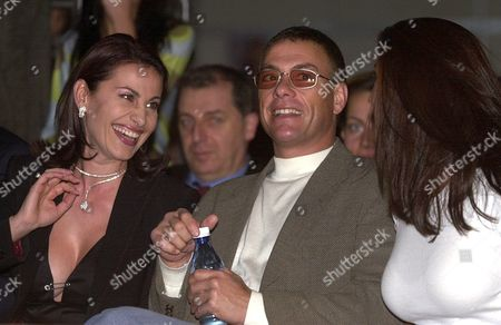 Stock Photo of Sofia Bulgaria : Hollywood Movie Star Jean Claude Van Damme (c) Watches a Fashion Show in Sofia on Late Tuesday 23 October 2001 Flanked by Darina Pavlova (l) Wife of One of Bulgarias Leading Businessmen Ilia Pavlov and an Unidentified Lady the Actor is in Bulgaria For the Shooting of His New Movie