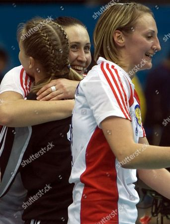 Russian Players Ludmila Postnova (c) Embraces Inna Suslina and Ekaterina Andryushina Stands on the First Row As They Celebrate Their Victory Against Norway at the Xix World Women's Handball Championship in Nanjing China 18 December 2009 China Nanjing