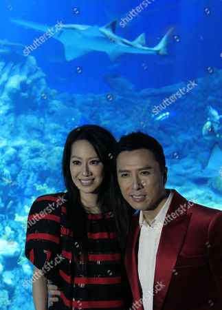Hong Kong Actor Donnie Yen and Wife Cissy Wang Poses at the Grand Aquarium During the Opening Ceremony of Aqua City in Ocean Park in Hong Kong China 25 January 2011 the Aqua City Part of Ocean Park Hong Kong Includes a Grand Aquarium with 5 000 Fish of Over 400 Species Symbio Show a New and Spectacular Nighttime Water and Flame Special Effects Show Featuring the Worlds First 360-degree Water Projection Screen; 15 000 Square Feet of Themed Retail and Dining Space; Ocean Square a New Entry-exit Plaza with Live Animals Water and Sculpture Features As Well As Neptunes Restaurant a Unique Fine Dining Restaurant Situated Inside the Aquarium Which Offers Diners a Stunning Panoramic View of Aquatic Life Epa/ym Yik China Hong Kong