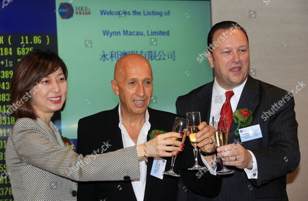 Stock Photo of (l-r) Linda Chen Executive Director and Chief Operating Officer of Wynn Macau Ltd Allan Zeman Non-executive Director of Wynn Macau Ltd and Ian Michael Coughlan Executive Director and President of Wynn Resort (macau) Sa Wynn Macau Ltd Toast During the Company 'S Listening Ceremony of the Initial Public Offering at Hong Kong Stocks Exchange in Hong Kong China 09 October 2009 Las Vegas-based Casino Operator Wynn Resorts (wynn) Macau Unit Wynn Macau Ltd Rose 13 Per Cent on Its First Day of Trading in Hong Kong China Hong Kong