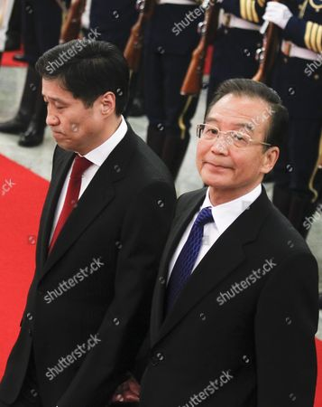 Chinese Premier Wen Jiabao (r) Walks with Mongolian Prime Minister Sukhbaataryn Batbold (l) During a Welcome Ceremony Inside the Great Hall of the People in Beijing China 16 June 2011 Batbold is in China on a 3-day Official Visit China Beijing