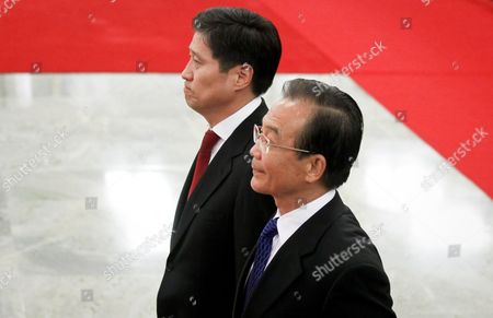Chinese Premier Wen Jiabao (down) Walks with Mongolian Prime Minister Sukhbaataryn Batbold (up) During a Welcome Ceremony Inside the Great Hall of the People in Beijing China 16 June 2011 Batbold is in China on a 3-day Official Visit China Beijing
