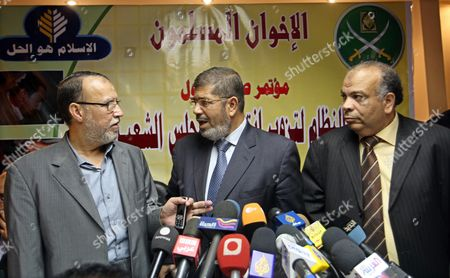 Stock Photo of Senior Muslim Brotherhood Leader Essam Erian (l) Talks with Mohamed Morsi (c) Spokesman of Egypt's Muslim Brotherhood and Egyptian Parliamentarian Mohamed Said El-ketatni (r) During a Press Conference Under the Slogan 'Stopping Elections Fraud is a National Duty' in Cairo Egypt 22 November 2010 the Muslim Brotherhood Has Accused the Government of Arresting Dozens of Its Members Since It Announced It Would Run For the Upcoming 28 November Parliamentary Elections the Muslim Brotherhood is Officialy Banned But Candidates Can Run As Independents Egypt Cairo