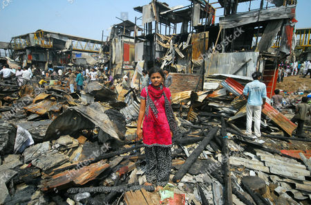 Rubina Ali (c) who Acted As Young Latika in the Oscar-winning Film 'Slumdog Millionaire' Inspects the Ruins of the Shanty She Lived in at Garib Nagar Slums Mumbai India 05 March 2011 a Fire Gutted the Slum a Large Shanty Town Which is Home to Thousands of Residents Next to Bandra Station in Mumbai's Suburbs on 04 March 2011 India Mumbai