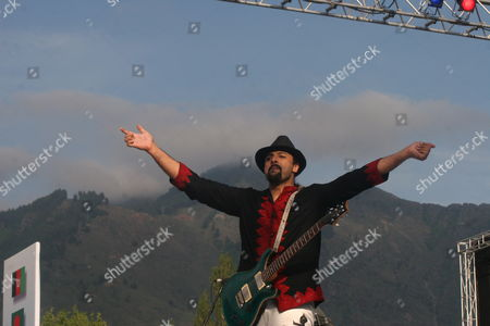 Uncropped Version of Epa01357376 ------------------------- Salman Ahmad Lead Singer of Pakistani Rock Band Junoon Performs During a Concert in Srinagar Indian Kashmir 25 May 2008 Thousands of Strife Weary Kashmiris Usually Accustomed to Sound of Bombs and Rattle of Gunfire Screamed with Joy Clapped and Danced to the Beat of Music by Junoon the Concert Biggest Musical Event in the Disputed Kashmir Region in Nearly Two Decades in a Bid For Peace was Held Amid Tight Security on the Banks of Region's Famous Dal Lake Ringed by Lofty Himalayan India Srinagar