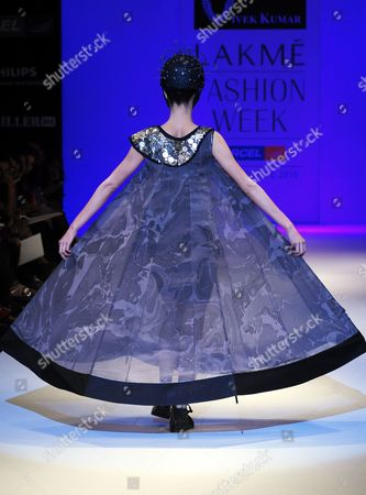 Stock Image of A Model Presents a Creation by Indian Fashion Designer Vivek Kumar at the Lakme Fashion Week Winter/festive 2010 in Mumbai India 20 September 2010 Some 74 Designers Will Showcase Their Collections at the Fashion Event Running From 17 to 21 September India Mumbai
