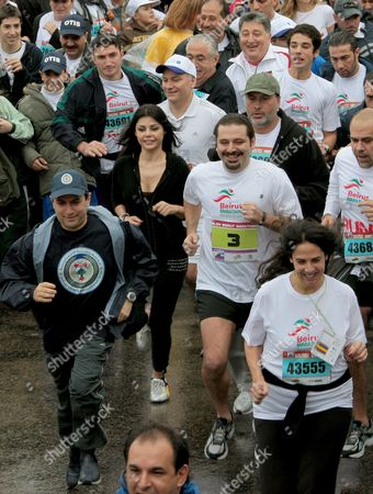 Lebanese Prime Minister Saad Hariri (3r) Lebanese Interior Minister Ziad Baroud ( L) Lebanese Artist Haifa Wehbe (behind L) and Other Lebanese and Foreign Participants Take Part in the 10 Kilometers 'Fun Run' of the Annual Beirut International Marathon in Downtown Beirut Lebanon 06 December 2009 More Than 31000 Participates From 61 European and Arabic Countries Took Part in the Beirut Marathon Under the Moto'it's Time to Run' Ethiopian Mohammed Hussein Won the 42 Km Race Followed by Eston Ngiar From Kenya (2nd) and Abraham Belete From Ethiopia (3rd) Lebanon Beirut