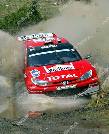 British Rally Richard Burns and His Co-driver Robert Reid Drive Their Peugeot 206 Wrc Through the Muddy Waters of the Special Stage of Rengini in the 50th Rally Acropolis Saturday 07 June 2003 the Rally Part of the World Rally Championship ( Wrc) Takes Place From 05 to 08 June in Central Greece Epa-photo/epa/louisa Gouliamaki Greece Rengini