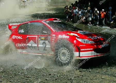 Marlboro Peugeot Total Team British Richard Burns and Rober Reid with Their Peugeot 206 Wrc at the Special Stage of the Second Leg From Fioni to Koilinia During the 31th Cyprus Rally Saturday 21 June 2003 Epa Photo/epa/katia Christodoulou Cyprus Foini