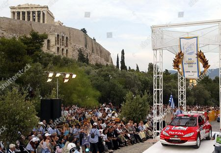 Marlboro Peugeot Total Team British Richard Burns and Rober Reid with Their Peugeot 206 Wrc at the Official Start of the 50th Golden Acropolis Rally in Athens at the Steps of Acropolis (l) on Thursday 05 June 2003 the Rally Part of the World Rally Championship ( Wrc) Takes Place From 5th to 8th June in Central Greece Epa-photo/epa/louisa Gouliamaki Greece Athens