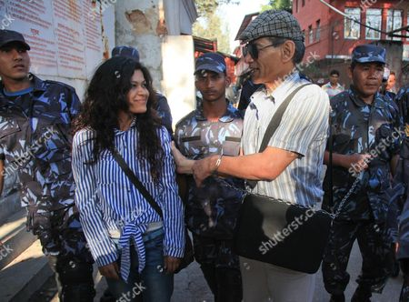 French National Charles Sobhraj (r) is Escorted by His Nepalese Wife Nihita Biswas 22 After Appearing For His Hearing at the District Court in Kathmandu Nepal 31 May 2011 Sobraj Nicknamed 'Bikini Killer' is Linked to a Series of Backpacker Killings in Asia in the 1970s Sobraj Has Been Sentenced to Life Imprisonment in 2004 Nepal Kathmandu