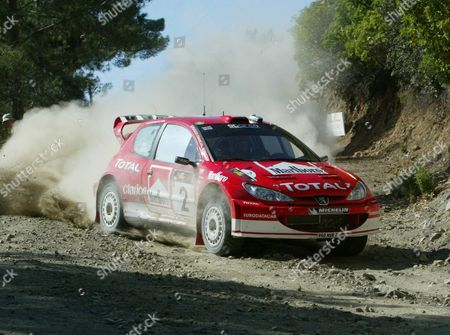 Marlboro Peugeot Total Team British Richard Burns and Rober Reid Drive in Their Peugeot 206 Wrc at the Special Stage of the First Leg 1 From Platres to Kato Amiantos During the 31th Cyprus Rally Which Started Friday 20 June 2003 Epa Photo/epa/katia Christodoulou Cyprus Platres
