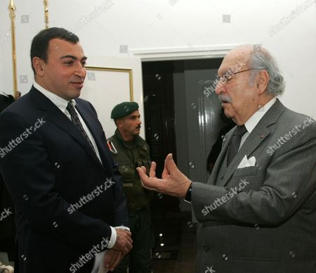 Tunisian Interim President Fouad Mebazaa (l) Talks Tunisian New Minister of Trade and Tourism Mehdi Houass (r) During the Swearing-in of the Interim National Unity Government in Tunis Tunisia 31 January 2011 the Head of Tunisia's Main Union Body Said That Prime Minister Mohammed Ghannouchi Had Agreed to Meet Critics Demanding His Removal Amid Signs That Mass Protests Were Running out of Steam Tunisia Tunis