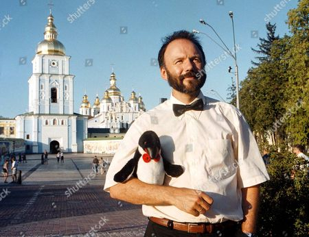 Stock Image of Kiev Ukraine: Portrait of Ukrainian Author Andrey Kurkov with His Mascot - a Stuffed Toy Penguin - Taken on Wednesday 23 June 1999 in Kiev a Penguin is One of the Main Characters in Kurkov's Last Novel Which is on Its Way to Become a Bestseller in the West