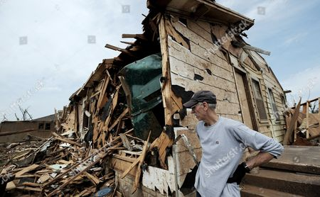 Stock Image of John Posey Looks at the Remains of His Home Including the Giant Dumpster That was Lodged Into His Kitchen (l) in the Tornado Ravaged Neighborhood of Alberta in Tuscaloosa Alabama Usa on 01 May 2011 There Are Reports That 255 People Have Been Killed in Alabama by the Powerful Tornados That Hit the State on the Evening of 30 April 2011 United States Tuscaloosa