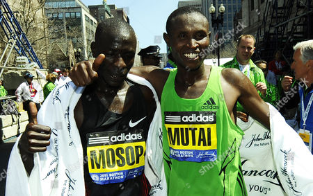 Stock Picture of Winner Geoffrey Mutai of Kenya (r) and Second Place Finisher Moses Mosop Also of Kenya (l) Gesture in the Finish Area of the 115th Boston Marathon After Mutai Finished with the Fastest Time Ever For a Marathon in Boston Massachusetts Usa 18 April 2011 Kenyan Geoffrey Mutai Won the Boston Marathon in Record Pace Completing the Men's Race in 2:03:02 United States Boston