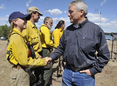 Colorado Governor Bill Ritter (r) Thanks Lefthand Fire Protection District Firefighter Molly Wineteer For Her Efforts Following a Press Conference Updating the Status of the Fourmile Canyon Fire Near Boulder Colorado Usa 10 September 2010 the Fire the Most Destructive in Colorado History in Terms of Homes Destroyed Could Be Fully Contained in Three to Five Days Officials Said Midday on 10 September 2010 United States Boulder