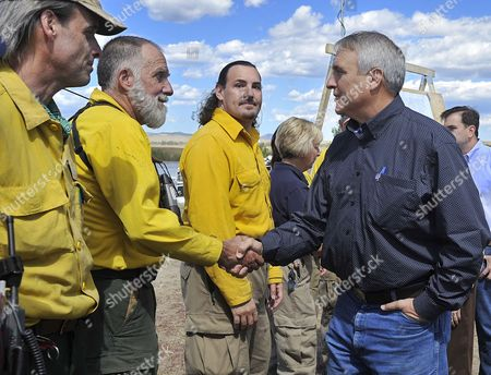 Colorado Governor Bill Ritter (r) Thanks Boulder Heights Firefighter Rob Bozeman Following a Press Conference Updating the Status of the Fourmile Canyon Fire Near Boulder Colorado 10 September 2010 the Blaze the Most Destructive in Colorado History in Terms of Homes Destroyed Could Be Fully Contained in Three to Five Days Officials Said Midday Friday United States Boulder