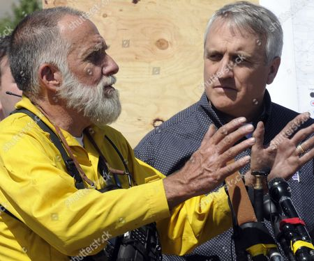 Colorado Governor Bill Ritter Listens to Boulder Heights Firefighter Rob Bozeman Discribe Fighting the Fourmile Canyon Fire Near Boulder Colorado Usa 10 September 2010 the Fire the Most Destructive in Colorado History in Terms of Homes Destroyed Could Be Fully Contained in Three to Five Days Officials Said Midday on 10 September 2010 United States Boulder
