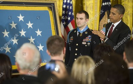 Stock Photo of Us President Barack Obama Awards Army Staff Sergeant Salvatore Giunta the Medal of Honor For Conspicuous Gallantry the Highest Award For Valor Bestowed Upon an Individual Serving in the U S Armed Forces in the East Room of the White House on 16 November 2010 Giunta is the First Time Living Recipient of the Medal Since the Vietnam War Giunta Earned the Medal of Honor For His Actions in Afghanistan United States Washington