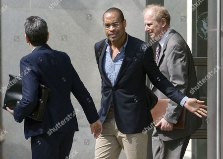 Former Citigroup Inc Executive Gary Foster (c) Leaves the United States Federal Court After a Hearing About Charges Against Him That He Embezzled More Than 19 Million Us Dollars From Citigroup in Brooklyn New York Usa on 27 June 2011 Foster a Fomer Vice President of the Company Allegedly Wired the Money to a Personal Account Between May 2009 and December 2010 United States New York