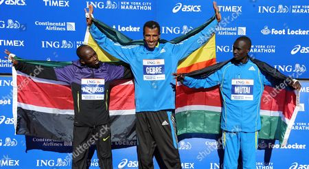 Gebre Gebremariam (c) of Ethiopia Celebrates After Winning the 2010 New York City Marathon During the Medals Ceremony While Standing with Second Place Finisher Emmanuel Mutai (r) of Kenya and Third Place Finisher Moses Kigen Kipkosgei (l) of Kenya in New York New York Usa on 07 November 2010 United States New York
