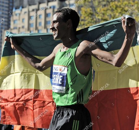 Gebre Gebremariam of Ethiopia Holds an Ethiopian Flag After Winning the 2010 New York City Marathon in New York New York Usa on 07 November 2010 United States New York