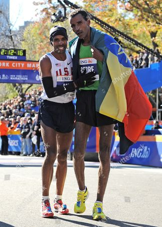 Gebre Gebremariam (r) of Ethiopia Embraces Meb Keflezighi (l) of the United States After Winning the 2010 New York City Marathon in New York New York Usa on 07 November 2010 United States New York