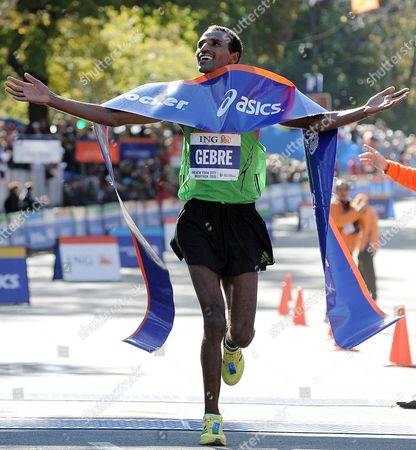 Gebre Gebremariam of Ethiopia Celebrates After Crossing the Finish Line in First Place at the 2010 New York City Marathon in New York New York Usa on 07 November 2010 United States New York