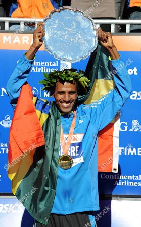 Gebre Gebremariam of Ethiopia Holds Up His Trophy After Winning the 2010 New York City Marathon in New York New York Usa on 07 November 2010 United States New York
